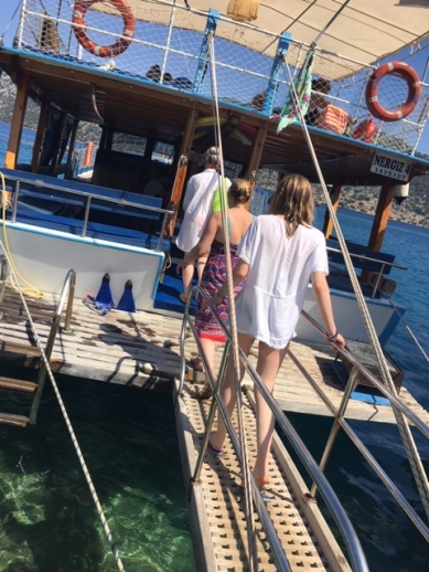 Girls boarding boat