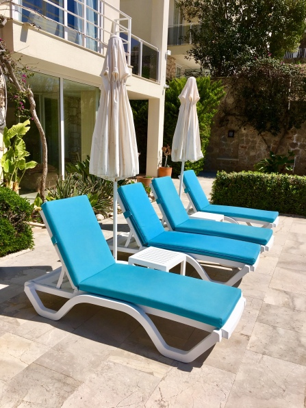 Sunbeds outside apartment